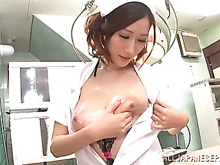 Delightsome oriental sweetheart caresses her large milk shakes whilst getting fucked hardcore