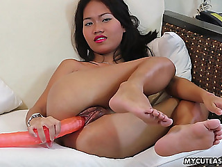 Her big toy slides so easily into her fat Asian cunt